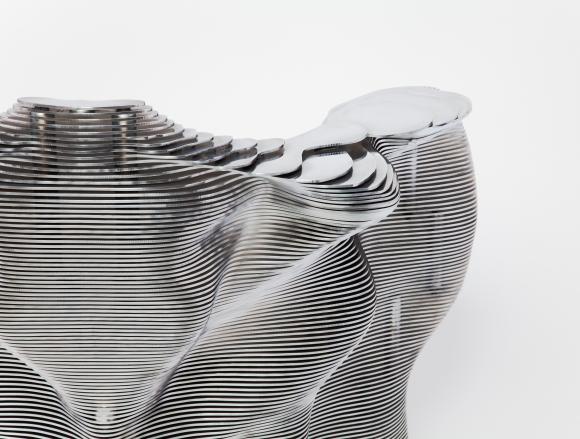 Mathias Bengtsson (Danish, b. 1971) Slice Chair, 1999. Aluminum; 29 1/2 x 35 x 29 in. Milwaukee Art Museum, Gift of Friends of Art M2011.11. Photo credit John R. Glembin. © Mathias Bengtsson, Courtesy of Industry Gallery