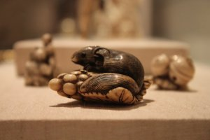 Japanese, Squirrel with Grapes (netsuke), 19th-20th century. Stained ivory. Gift of the Margaret and Fred Loock Foundation.