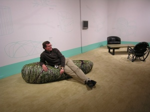 Jon Prown, Executive Director of Chipstone, sitting on Tanya Aguiñiga's Rock Sofa