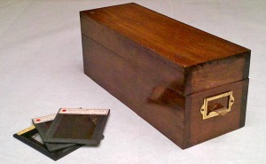 Wood lantern slide box with brass pull and glass lantern slides, early 20th century. Milwaukee Art Museum, Institutional Archives.