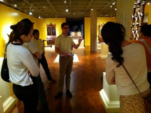 Ethan Lasser taking the group around the decorative arts galleries at the Milwaukee Art Museum