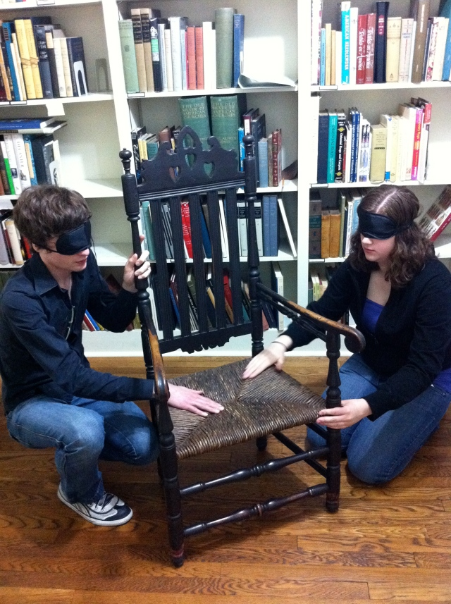 Two of the students participating in the blindfold exercise