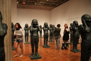 "Teens explore the ""Chinese Contemporary Warriors"" installation by Yue Minjun."