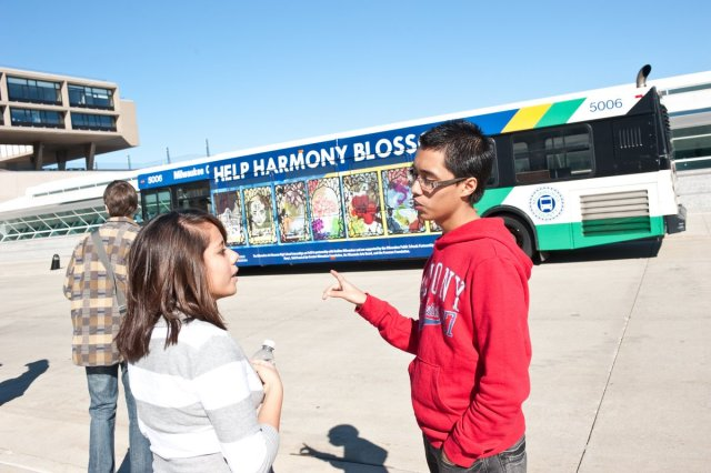 Araceli and Juan discuss the bus. Photo by Mark Hines