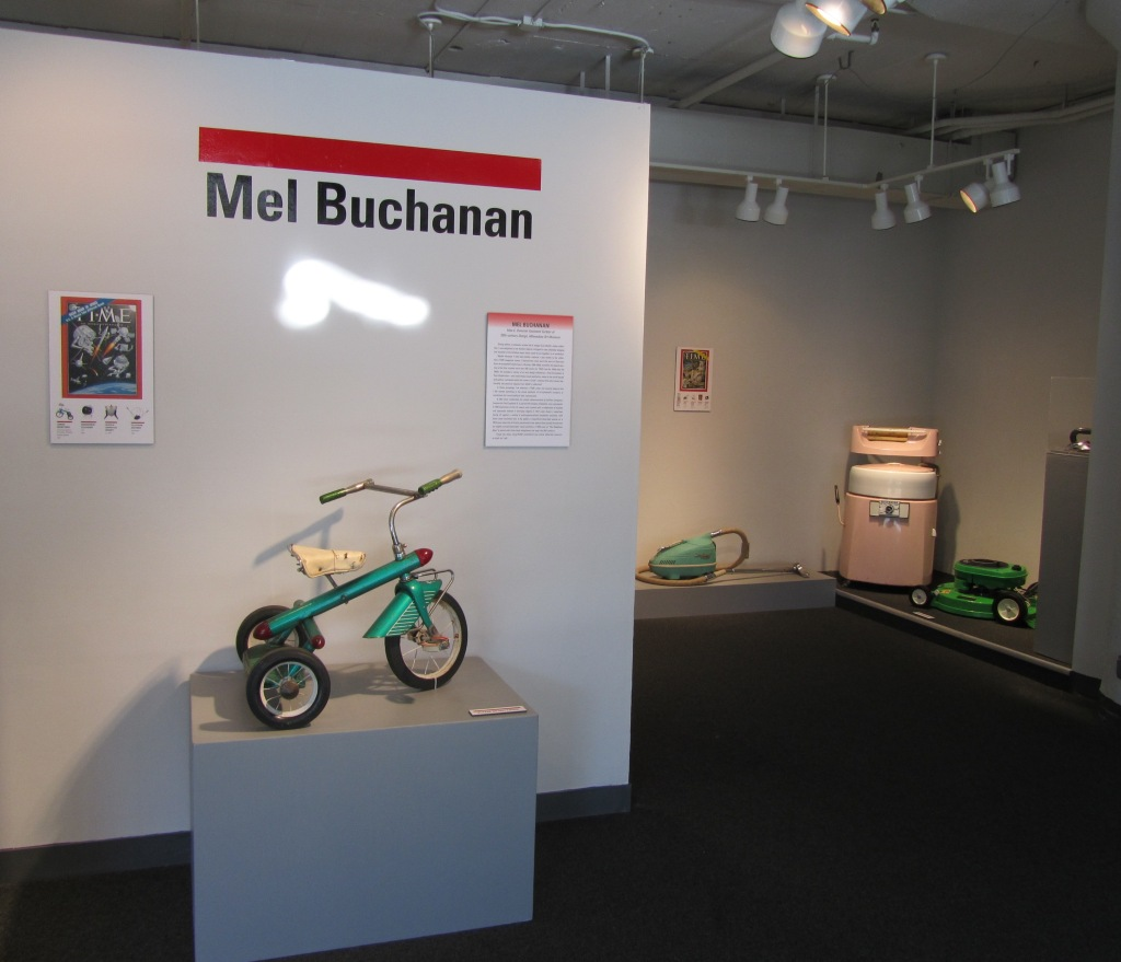 "Installation shot showing Mel Buchanan's installation, MIAD's ""Style, Innovation, & Vision: Six Perspectives of a Design Collection"" exhibition. Photo by the author.Installation shot showing Ryan Ramos's installation, MIAD's ""Style, Innovation, & Vision: Six Perspectives of a Design Collection"" exhibition. Photo by the author."