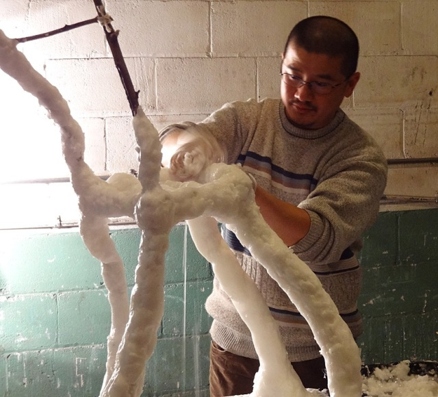 Hongtao Zhou applying and molding wax on the chair- Photo by Jeff Redmon