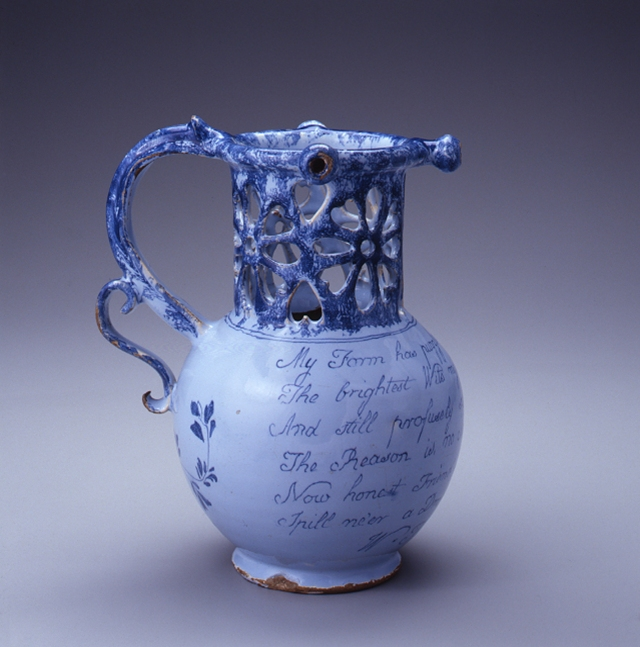 Puzzle Jug, 1771. Bristol, England. Buff earthenware/Bluish-white tin glaze. Chipstone Foundation Collection; Photo by Gavin Ashworth