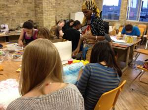 ArtWorks students creating found art pieces at RedLine Milwaukee. Photo by the author
