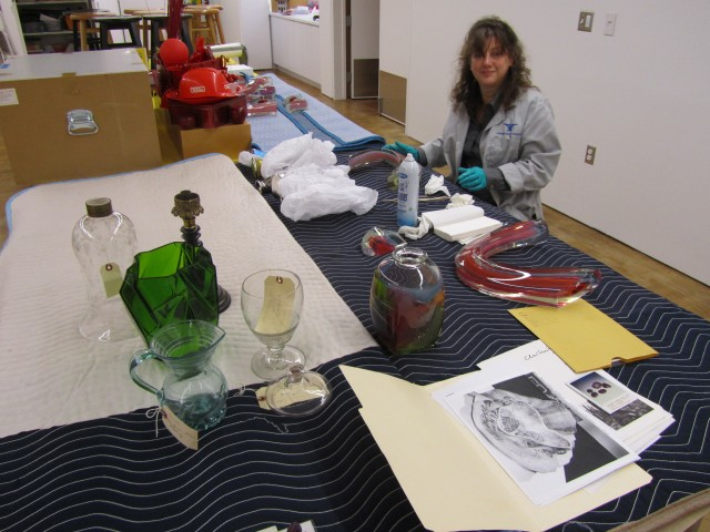 Museum staff working on American Studio Glass installation. Photo by the author.