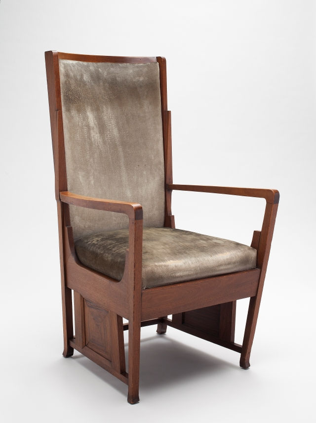 George Mann Niedecken (American, 1878–1945), Upholstered Armchair for the Frank T. Boesel Residence (Milwaukee, WI), ca. 1907. Walnut, walnut veneer, and original velour upholstery; 46 1/2 x 25 1/4 x 25 3/4 in. Milwaukee Art Museum, Purchase, with funds from the Mae E. Demmer Charitable Trust in memory of Lawrence E. Demmer M2012.296. Photo by John R. Glembin.