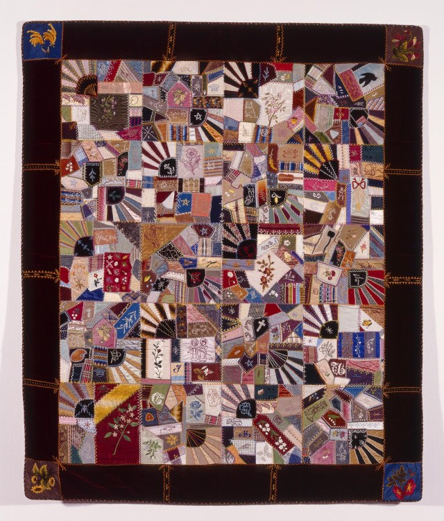 Margaret A. Beattie (American, b. ca. 1860), Crazy Quilt, 1883. Silk floss, silk chenille, metallic yarn, and oil paint on silk and silk velvet; 76 x 64 1/2 in. Milwaukee Art Museum, Purchase, with funds from Marion Wolfe, Mrs. Helen L. Pfeifer and Friends of Art, M1997.58. Photo by Larry Sanders.