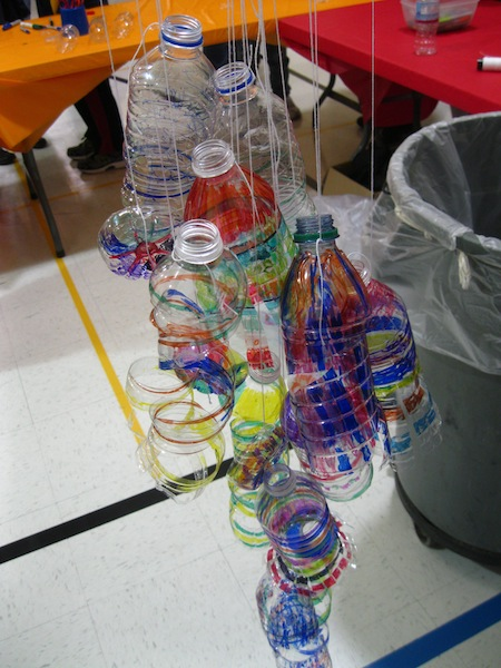 The process continues: cut the bottles with scissors to create the curls of plastic, reminiscent of Chihuly's blown glass.