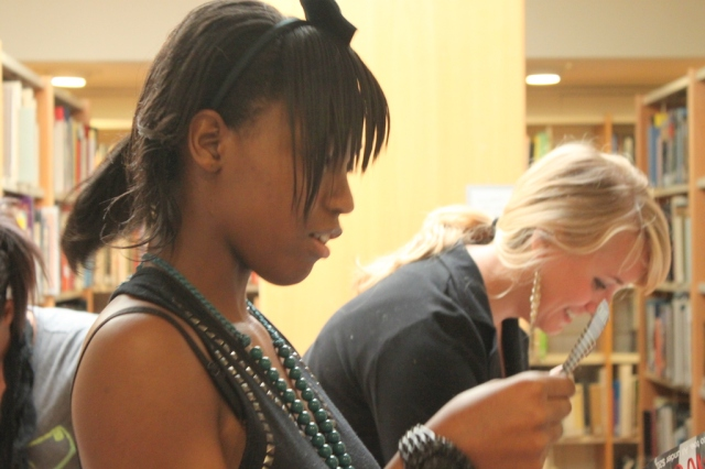 Na-Tiyana considering options for her project. Photo by Chelsea Kelly