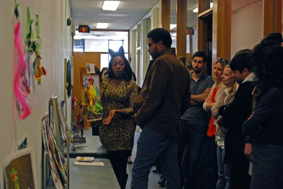 Ebony from Development pitches their entry to Reginald Baylor. Photo by Donele Pettit