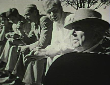 Film still: Frank Lloyd Wright with his students in the garden at Taliesin, early 1930s. Milwaukee Art Museum, Institutional Archives.