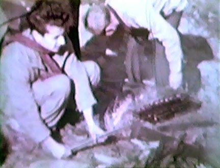 Film still: Roasting hot dogs during a picnic outing at Taliesin, late 1930s-early 1940s. Milwaukee Art Museum, Institutional Archives.