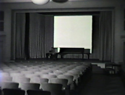 Film still: Interior of the Milwaukee Art Institute's lecture hall, circa 1957. Milwaukee Art Museum, Institutional Archives.
