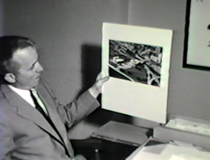 Film still: Director Edward Dwight with a rendering of the Eero Saarinen-designed War Memorial and Milwaukee Art Center building, circa 1957. Milwaukee Art Museum, Institutional Archives.