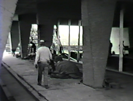 Film still: Construction of the exterior of the Eero Saarinen-designed War Memorial and Milwaukee Art Center building, circa 1957. Milwaukee Art Museum, Institutional Archives.