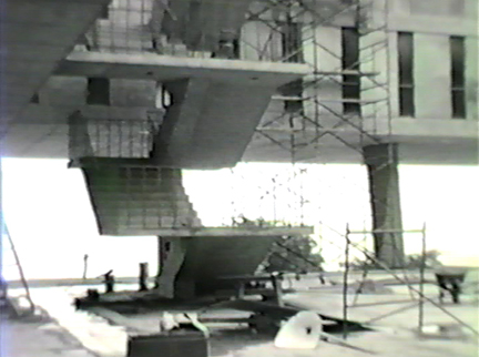 Film still: Construction of the exterior of the Eero Saarinen-designed War Memorial and Milwaukee Art Center building, circa 1957. Milwaukee Art Museum, Institutional Archives.