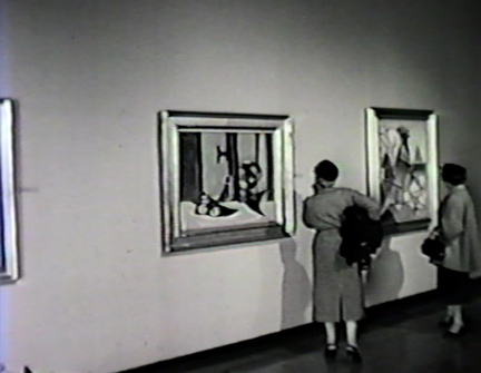 Film still: Visitors enjoying the Milwaukee Art Center's inaugural exhibition, 1957. Milwaukee Art Museum, Institutional Archives.
