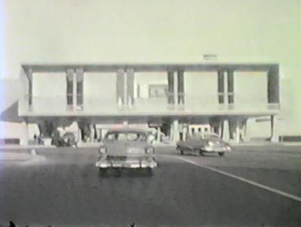 Film still: View from the Mason Street Bridge of the exterior of the Eero Saarinen-designed War Memorial and Milwaukee Art Center building circa 1957. Milwaukee Art Museum, Institutional Archives.