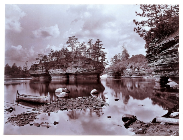 Henry Hamilton Bennett (American, 1843–1908). Lone Rock with Canoe, Wisconsin Dells, ca. 1890s–1908. Gelatin silver printing-out paper. Milwaukee Art Museum, Gift of H. H. Bennett Studio Foundation, Inc. Photo credit Larry Sanders