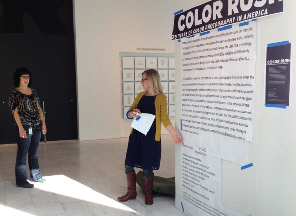 Curator Katherine Bussard (left) and Lead Designer Leslie Boll (right) discuss placement on the intro panels
