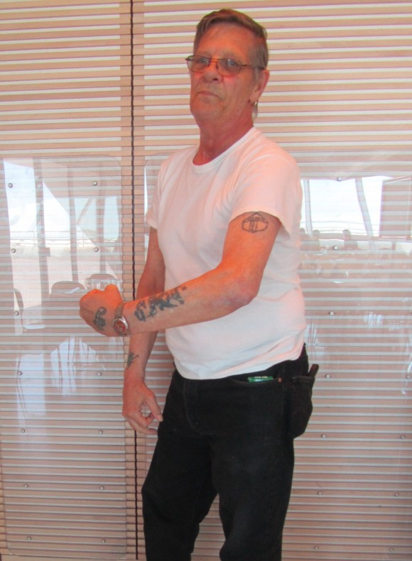 Harold Wright exhibits his Amund Dietzel tattoos in Cafe Calatrava. Photo by the author.
