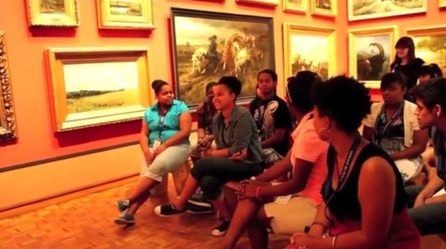 Teens look at artwork in the Museum galleries. Screenshot of student final project video.