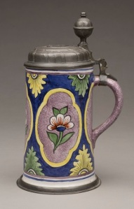 Probably Schrezheim, Germany Tankard, second half of 18th century. Tin‑glazed earthenware with polychrome decoration, pewter, and coin silver. Milwaukee Art Museum, Bequest of Dorothy Trommel in memory of her parents, Eunice and Howard Wertenberg M2013.42.  Photo by John Glembin