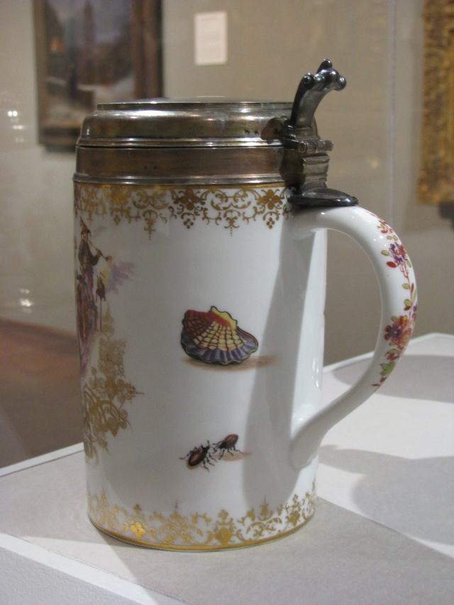 Meissen Porcelain Manufactory (Dresden, Germany, established 1710), Possibly Johann Gregorius Horoldt (German, 1696-1775), Tankard, ca. 1725. Glazed porcelain, polychrome overglaze decoration, gilding, and brass. Milwaukee Art Museum, Gift of the René von Schleinitz Foundation, M1962.1035. Photo: Catherine Sawinski
