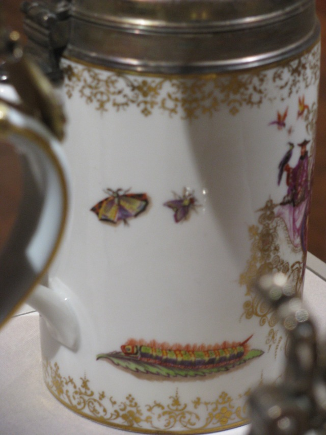 Meissen Porcelain Manufactory (Dresden, Germany, established 1710), Possibly Johann Gregorius Horoldt (German, 1696-1775), Tankard, ca. 1725. Glazed porcelain, polychrome overglaze decoration, gilding, and brass. Milwaukee Art Museum, Gift of the René von Schleinitz Foundation, M1995.2. Photo: Catherine Sawinski