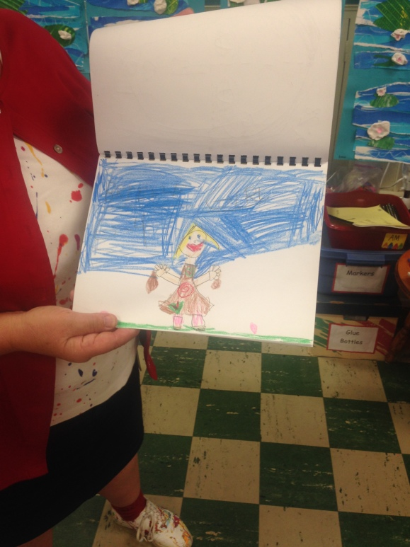 Ms. G. shows student art. Photo by Laci Coppins