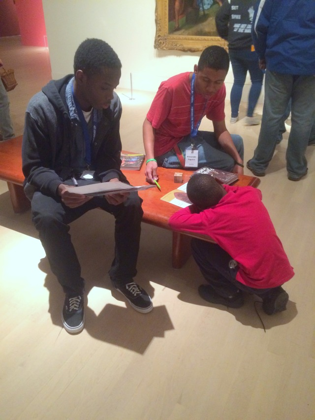 Nhyji and Alex work with an MPS elementary school student in Of Heaven and Earth. Photo by Chelsea Emelie Kelly