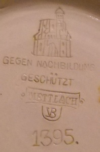 "Marks on the bottom of a Mettlach stein. Villeroy & Boch (Mettlach, Saarland, Germany, established 1836), designed by Christian Warth (German, active 1854–1892). ""1395"" Stein, 1885. Stoneware with colored slip and glaze decoration, gilding and pewter. Milwaukee Art Museum, Bequest of Dorothy Trommel in memory of her parents, Eunice and Howard Wertenberg M2013.43.  Photo credit: the author."