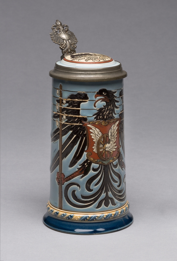 """Villeroy & Boch (Mettlach, Saarland, Germany, established 1836), design attributed to Otto Hupp (German, 1859–1949). """"2075"""" Stein, 1900. Stoneware, with colored slip and glaze decoration, gilding, and pewter. Milwaukee Art Museum, Gift of the René von Schleinitz Foundation M1962.567. Photo credit: John R. Glembin."""