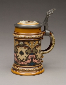 "Villeroy & Boch (Mettlach, Saarland, Germany, established 1836), designed by Christian Warth (German, active 1854–1892). ""1395"" Stein, 1885. Stoneware with colored slip and glaze decoration, gilding and pewter. Milwaukee Art Museum, Bequest of Dorothy Trommel in memory of her parents, Eunice and Howard Wertenberg M2013.43.  Photo credit: John Glembin."