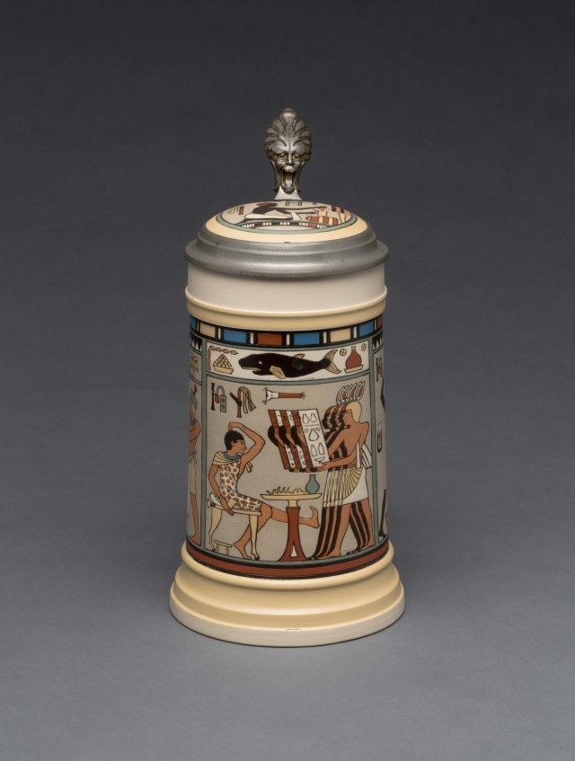"Villeroy & Boch (Mettlach, Saarland, Germany, established 1836), designed by Fritz Quidenus (German, 1867–1928). ""2583"" Stein, 1900. Stoneware, colored slip decoration, and pewter. Gift of the René von Schleinitz Foundation M1962.390. Photo credit: John R. Glembin"