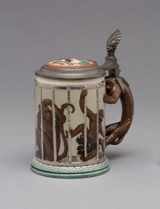 "Villeroy & Boch (Mettlach, Saarland, Germany, established 1836), design attributed to Franz von Stuck (German, 1863–1928). ""2106"" Stein, 1894. Stoneware, with colored slip and glaze decoration, platinum luster, and pewter. Gift of the René von Schleinitz Foundation M1962.890. Photo credit: John R. Glembin."