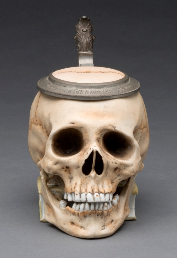 "Ernst Bohne Söhne, Rudolstadt (Thuringia, Germany, 1854–ca. 1920). ""Skull"" Stein, ca. 1900. Glazed hard paste porcelain, colored underglaze decoration, and pewter. Milwaukee Art Museum, Gift of the René von Schleinitz Foundation M1962.948. Photo by John R. Glembin."