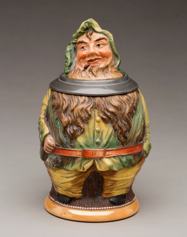 "German. ""Elf"" Stein, ca. 1900. Earthenware with colored slip and glaze decoration, and pewter. Milwaukee Art Museum, Bequest of Dorothy Trommel in memory of her parents, Eunice and Howard Wertenberg M2013.44. Photo by John R. Glembin."