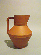 Christopher Dresser (English, 1834-1904) Manufactured by Watcombe Terracotta Clay Company (Torquay, Devon, England, established 1867) Pitcher, designed 1870-75; produced by Watcombe of Torquay. Terracotta or red stoneware, gilding 7 1/8 × 5 1/2 × 5 1/4 in. (18.1 × 13.97 × 13.34 cm) . Milwaukee Art Museum, Gift of Daniel Morris and Denis Gallion M1991.323