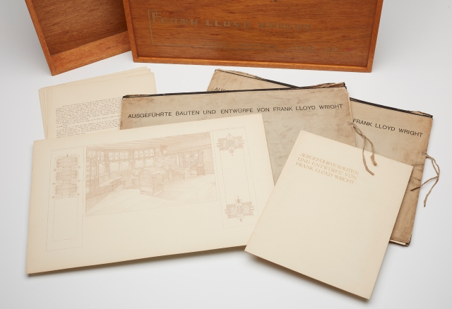 Documents and folders from the Wasmuth Portfolio in front of its original wooden box. Frank Lloyd Wright (American, 1867–1959), Wasmuth Portfolio (Ausgeführte Bauten und Entwürfe von Frank Lloyd Wright), 1910. 98 lithographs, 32 pages of German text, two cardboard slipcases, and a wooden box. Milwaukee Art Museum, Purchase, with funds from the Edward U. Demmer Foundation. M2014.54.1a,b–.73. Photo credit: John R. Glembin.