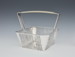 Josef Hoffmann (Austrian, 1870–1956), produced by Wiener Werkstätte (Vienna, Austria, 1903–1932), Basket, 1905. Silver and ivory. Milwaukee Art Museum, Purchase, with funds from the Demmer Charitable Trust, M2017.56. Photo by John R. Glembin.