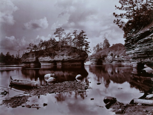 Henry Hamilton Bennett (American, 1843–1908), Lone Rock with Canoe, Wisconsin Dells, ca. 1890s–1908. Gelatin silver printing-out paper print. Milwaukee Art Museum, Gift of H. H. Bennett Studio Foundation, Inc. M1993.118. Photo credit: Larry Sanders.